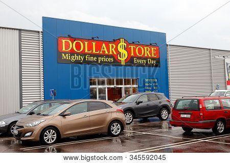 Hallsberg, Sweden - August 29, 2019: Car Parking Outside The Dollar Store Discount Store Entrance.