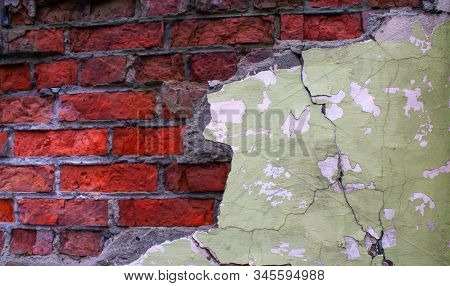 Red Brick Wall With Craks. Craks On Concrete. Old Brickwall With Craks.
