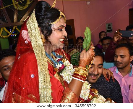 Midnapur, India - February 6, 2019: Indian Bride Hiding Her Face With Betel Leaf Also Called Paan. H