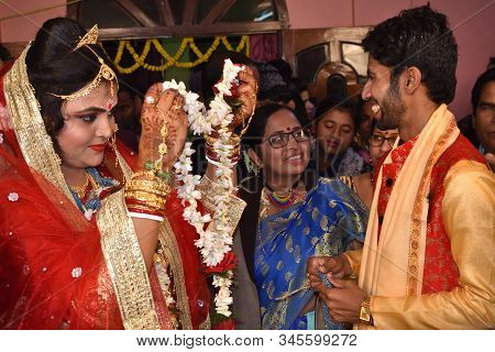 Midnapur, India - February 6, 2019: Indian Bengali Wedding Moment. Bride And Groom Exchanging Garlan