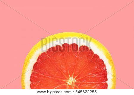 Semi Circle Slice Of Ripe Juicy Red Grapefruit On Cherry Pink Background. Citrus Fruits Summer Vitam