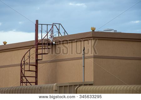 Red Rooftop Fire Escape Ladder On The Exterior Of A Residential House In The United Arab Emirates In