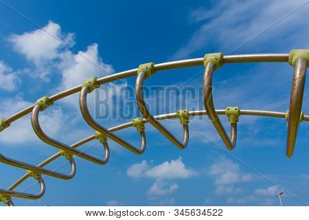Empty Monkey Bars At A Playground Side View Concept Looking To The Blue Sky. Goals Ahead And Holding