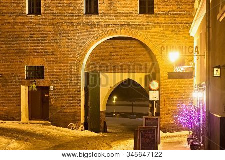 Torun, Poland - January 08, 2016: Night Winter View To The Arch In The Monastery Gate (brama Klaszto