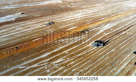 Wood Texture. A Wooden Bench. Cracks On The Log. Product From The Boards. Fresh Wood In Light Color.