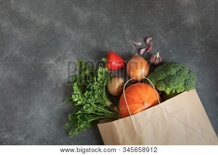 Zero Waste Use Less Plastic Concept. Shopping Bag Paper Full Of Fresh Organic Vegetables On Dark Bac