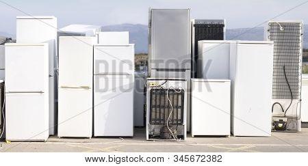 Old Fridge Freezer Refrigerator Refrigerant Gas At Refuse Dump Skip Recycle Stacked Pile Plant Help