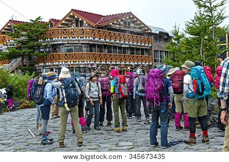 Mt. Fuji, Japan - August 22, 2016: Group Of Climbers Prepares To Go To The Top Of Mt. Fuji At The Mt