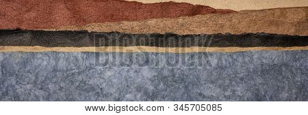abstract landscape in earth tones created with amate bark papers handmade in Mexico from Amate, Nettle, and Mulberry trees, panoramic banner