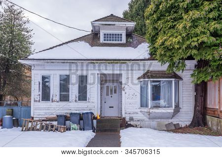 An Old House in Disrepair in Vancouver, Canada.