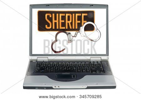 Hand Cuffs. Sheriff Patch with Handcuffs. Computer screen with Sheriff Patch and Handcuffs isolated on white. Room for text. Clipping Path. Bad people have to deal with the law and go to jail.