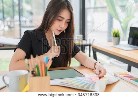 Beautiful Young Freelance Graphic Designer Choosing Color Samples For Designing Mobile Application S