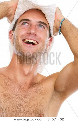 Portrait Of Happy Young Man In Beach Hat