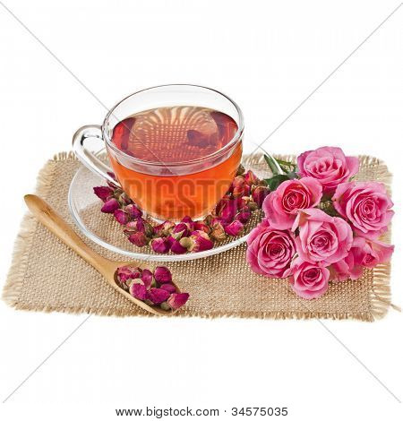 Tea Glass Cup with Fresh Rose flower buds isolated on white