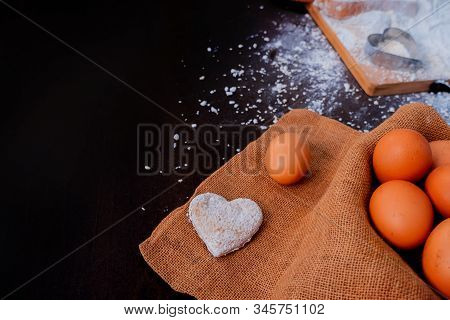 Kid Helping Mom For Cooking For Valentine's Day. Preparing An Ingredient With Powder And Flour. Dirt