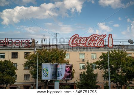 Almaty, Kazakhstan, Circa September 2019: Huge Red Coca Cola Brand On The Building. Coca-cola Is A W