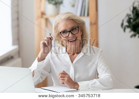 Aged Businesswoman Interviewing Applicant During Distant Job Interview Using Laptop