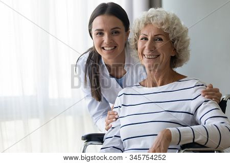 Head Shot Portrait Smiling Caregiver And Disabled Older Woman