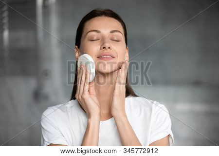 Head Shot Satisfied Woman Cleaning Skin With Facial Cleansing Sponge