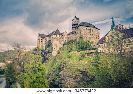 Loket Castle Hrad Loket Gothic Style Building On Massive Rock Over Eger River And Colorful Buildings
