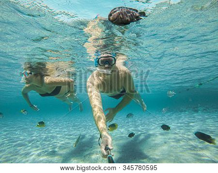 Young Couple Snorkeling Selfie Underwater Camera On The Coral Reef In Ocean Of Egypt Hurghada Travel