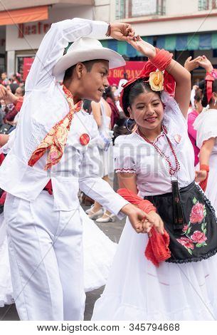 XALAPA, VERACRUZ, MEXICO- NOVEMBER 24, 2019: Young couple dancing and dressed with traditional cloth