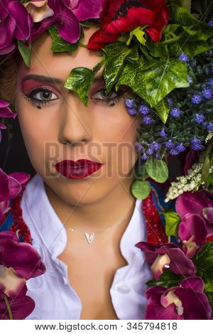 Young Fairy Woman With Flowers On Her Head