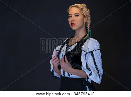 Blonde Woman In Black And White Folk Clothes