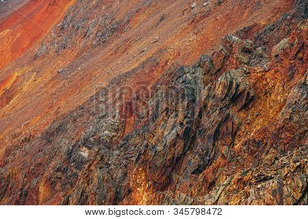 Vivid Multicolor Nature Background Of Big Rocky Mountain With Pointy Rocks. Full Frame Surface Of Gi