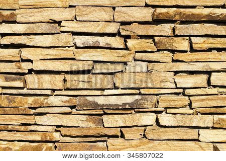 Masonry Made Of Light Natural Stone, With Sharp Shadows From The Sun
