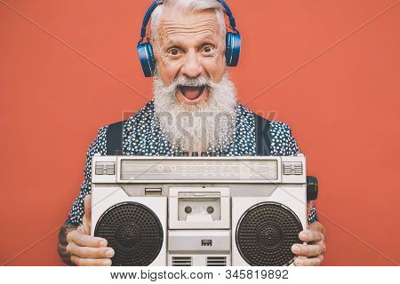 Happy Senior Man Listening To Music With Boombox And Headphones Outdoor - Crazy Hipster Male Having