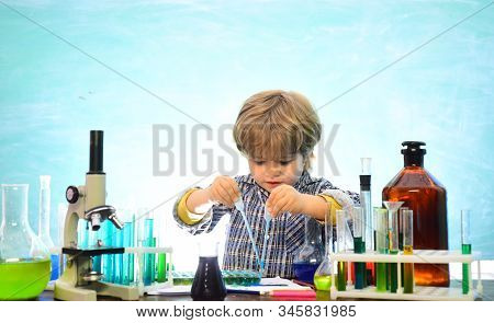 Little Kids Scientist Earning Chemistry In School Lab. Knowledge Day. School Chemistry Lessons. Firs