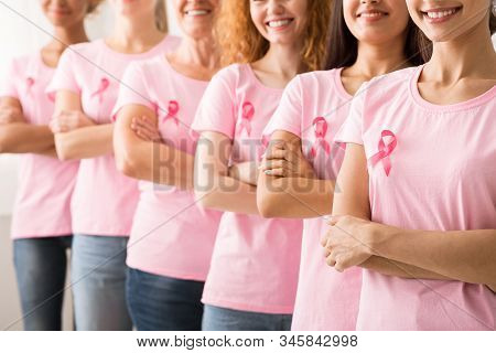 Breast Cancer Survivors. Group Of Diverse Women In Pink Awareness T-shirts Standing In Line On White