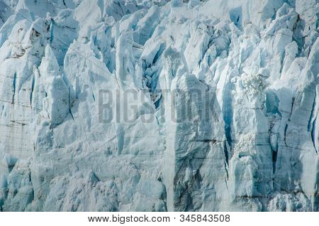 Close-up Of Seracs Caused By Slow-moving Glacial Ice Down A Mountain To The Sea.