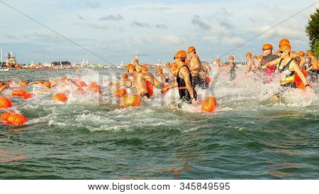 Labuan,malaysia-apr 27,2019:a Group Of Freestyle Swimmers Is Competing The International Cross Chann