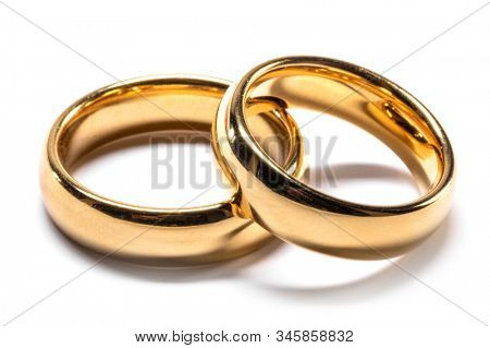 Couple of gold wedding rings isolated on white background