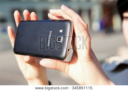 Moscow - January 2020: Photo of a Samsung Android smartphone. Smartphone in the hands, close-up. Girl takes a photo by phone.