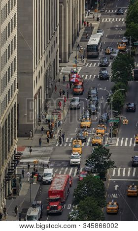 New York, Usa - August 1, 2019: Birds Eye View Of People, Traffic And Yellow Cabs In Midtown Manhatt