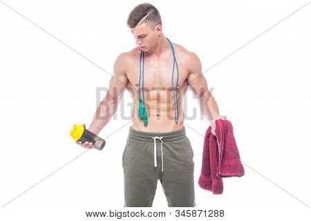 Muscular Man Skipping Rope. Portrait Of Muscular Young Man With Jumping Rope Drinking Water With Red