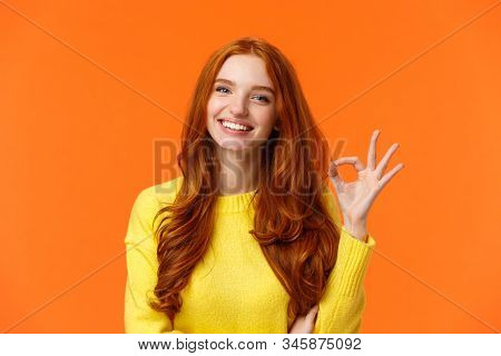 Satisfied Consumer Recommends Product. Cute Cheerful Feminine Redhead Woman With Pretty Smile, Showi