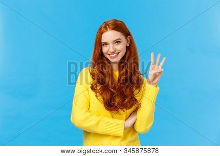Gorgeous Young Redhead Girl 20s In Yellow Sweater, Smiling Carefree Making Order, Reservetion For Th