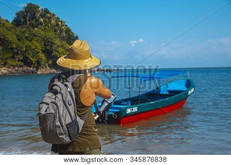 Tela, Honduras »; January 2020: A Young Local With A Straw Hat On The Beach Of Puerto Caribe In Punt