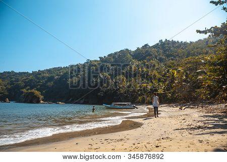 Walking On The Beach Of Puerto Caribe In Punta De Sal In The Caribbean Sea, Tela. Honduras
