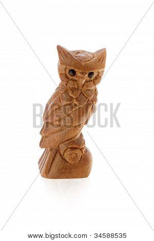 Wood owl with black eyes