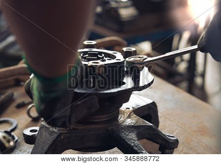 View Of Engineers Hands, Adjusting And Overhauling Used Vehicle Car Parts And Recycling Scrap Metal