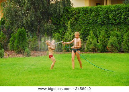 Boys Play On The Grass
