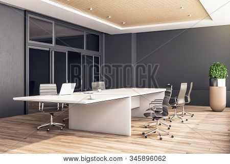 Modern Coworking Office In Minimalistic Interior With Laptop And Supplies On Table. 3d Rendering