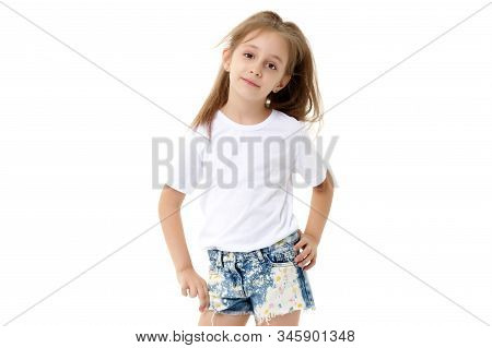 Beautiful Little Girl In Short Shorts And A Pure White T-shirt On Which You Can Make Any Inscription