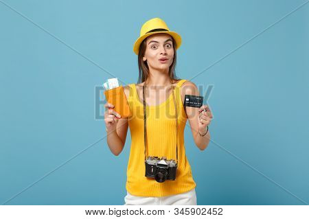 Traveler Tourist Woman In Yellow Clothes Hat Hold Tickets Credit Card Camera Isolated On Blue Backgr