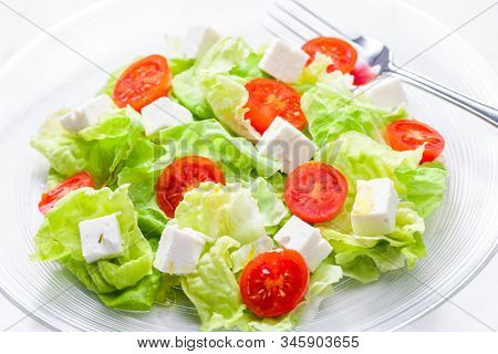 salad with fresh vegetables, feta cheese and tomatoes
